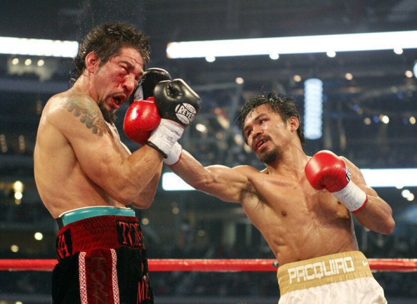 Boxers, such as Antonio Margarito, left, and Manny Pacquiao are currently required to undergo only one brain MRI test, which could be taken at the beginning of their careers.