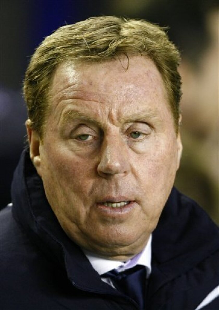 Tottenham manager Harry Redknapp looks on against Everton before their English Premier League soccer match at Goodison Park, Liverpool, England, Wednesday Jan. 5, 2011. (AP Photo/Tim Hales) NO INTERNET/MOBILE USAGE WITHOUT FOOTBALL ASSOCIATION PREMIER LEAGUE (FAPL) LICENCE. CALL +44 (0) 20 7864 9121 or EMAIL info@football-dataco.com FOR DETAILS