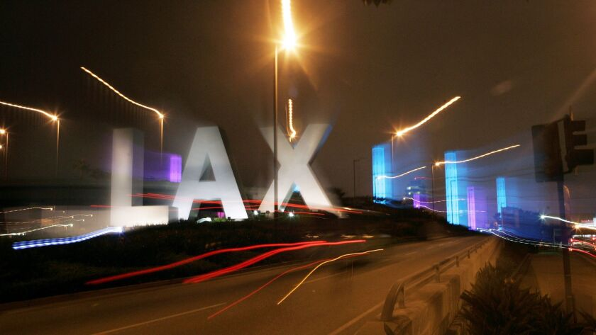 The colorful illuminated pylons around the entrance to LAX