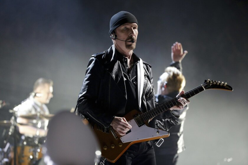 FILE - In this Sunday, Dec. 6, 2015 file photo, The Edge of U2 performs on stage during a concert, in Paris, Sunday, Dec. 6, 2015. The Sierra Club is suing the California Coastal Commission in an effort to halt approval of U2 guitarist The Edge's plans to build five mansions on a Malibu ridge, Thursday, Jan. 21, 2016. (AP Photo/Thibault Camus, File)