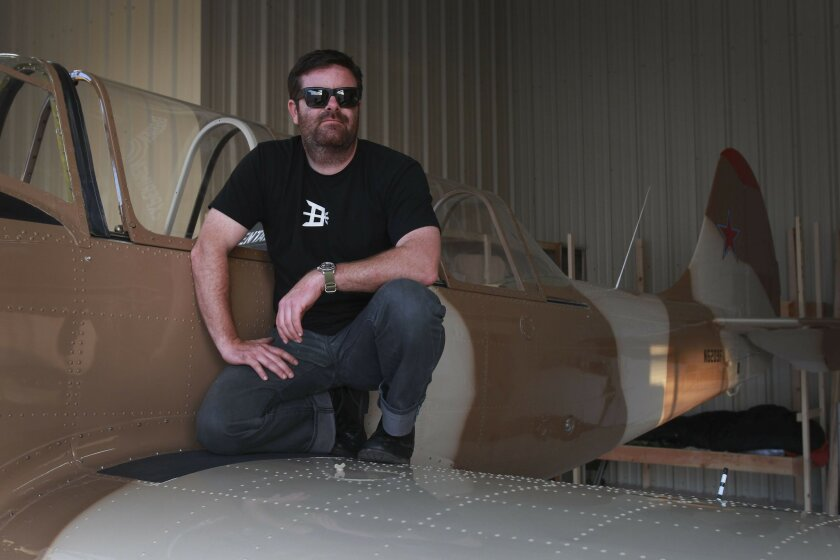 Brandon Webb, former Navy SEAL, author of book on Benghazi. Webb is seen next to his airplane which is a Russian Yak.