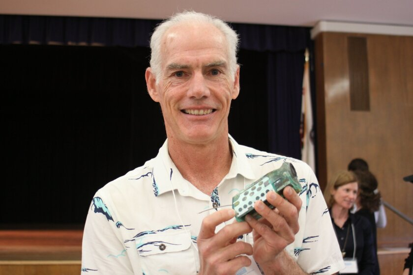 Engineer Bill Hagey shows an instrument he built used to track marine animals.