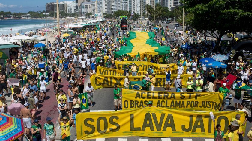 "Marchers at Copacabana Beach in Rio de Janeiro show their support in March for the ""Lava Jato,"" or Car Wash, anti-corruption investigation that has roiled Brazilian politics."