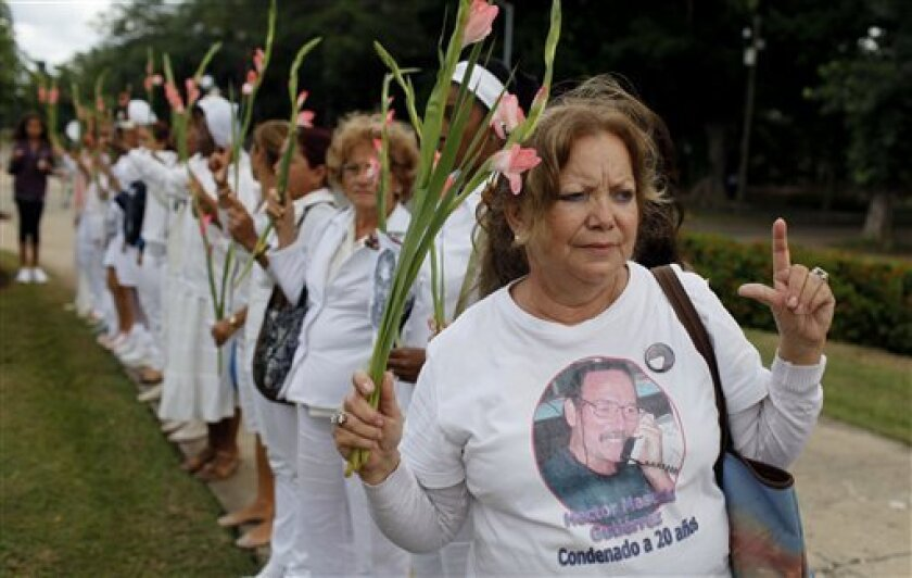 Laura Pollan, leader the Cuban dissident group Ladies in White, demonstrates after the group's weekly march in Havana, Cuba, Sunday Nov. 7, 2010. Ladies in White is an organization made up of wives and mothers of political prisoners. (AP Photo/Javier Galeano)