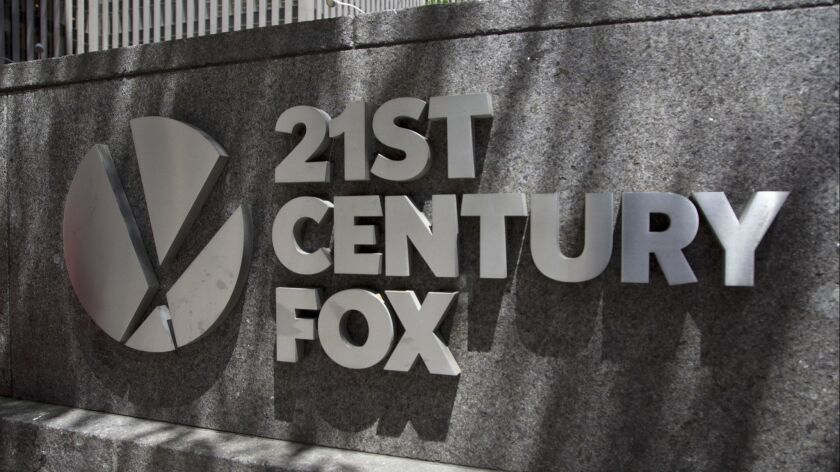 FILE - This June 14, 2018, file photo shows the 21st Century Fox logo outside its New York office. C