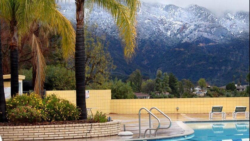 Snow covers the mountains behind the La Canada Flintridge country club, Monday Feb. 9, 2009.