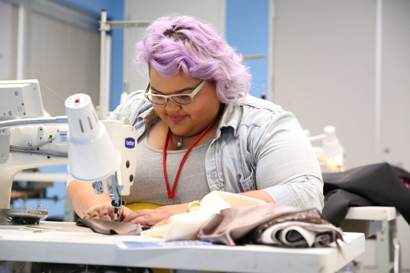 Ashley Nell Tipton working on a design in Project Runway season 14.