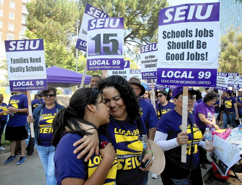 Juanita Turcios, a preschool teachers assistant, and daughter Nelcie rally in May for the $15 minimum wage that Los Angeles Unified School District board members just agreed to unanimously.