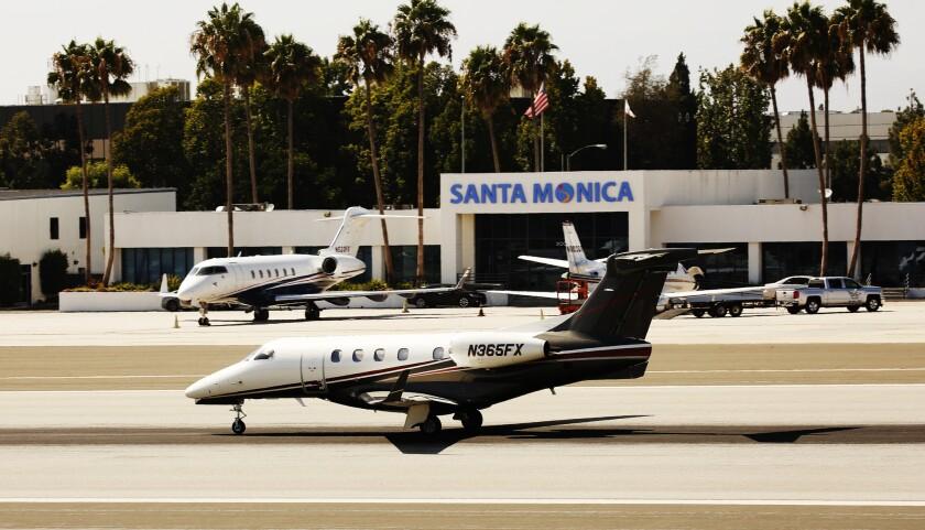 LOS ANGELES, CA AUGUST 31, 2016 -- Jet and small aircraft land and liftoff at Santa Monica Airport o