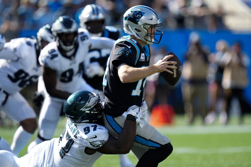 Carolina Panthers quarterback Sam Darnold is sacked by Philadelphia Eagles defensive tackle Javon Hargrave during the second half of an NFL football game Sunday, Oct. 10, 2021, in Charlotte, N.C. (AP Photo/Jacob Kupferman)