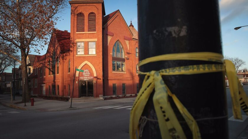 Crime scene tape is tied to a pole in Chicago across from the Labor of Love church, where a Christmas day shooting left Jamil Farley dead on Dec. 27, 2016.