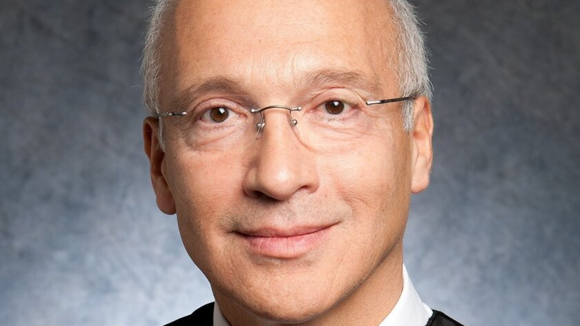 In an undated handout photo, Judge Gonzalo Curiel of the U.S. District Court for the Southern District of California. Curiel, whose handling of a lawsuit filed by former students of Donald Trump has drawn him into a political spotlight, once had to live in hiding after being threatened with assass