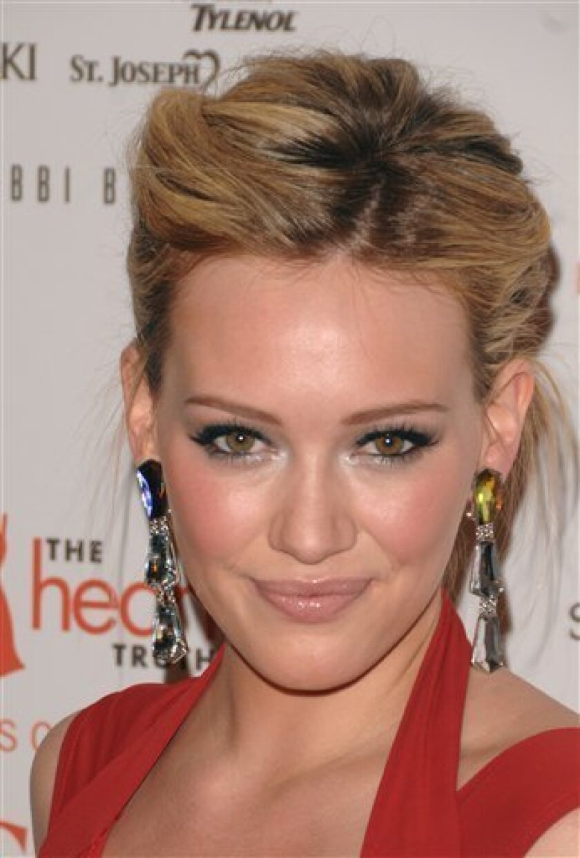 "FILE-This Feb. 13, 2009 file photo shows actress Hilary Duff arriving to the Heart Truth's Red Dress collection during Fashion Week in New York. Duff will be going the cast of ""Gossip Girl"". (AP Photo/Peter Kramer)"