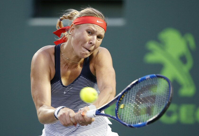 Lucie Hradecka of the Czech Republic, returns a shot from Eugenie Bouchard of Canada, during a match at the Miami Open tennis tournament, in Key Biscayne, Fla., Wednesday, March 23, 2016. Hradecka defeated Bouchard, 6-4, 3-6, 6-2. (AP Photo/Wilfredo Lee)