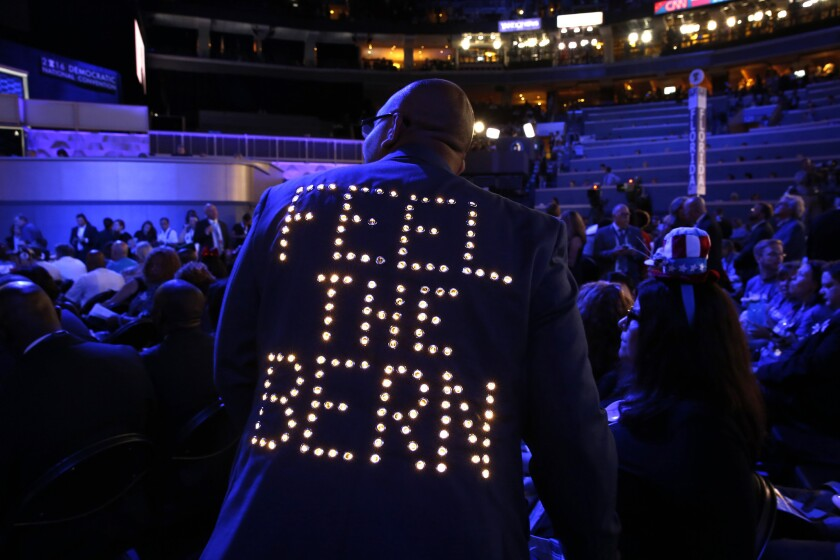 """""""Feel the Bern"""" lights up the back of a delegates jacket on the first night of the Democratic National Convention in Philadelphia."""