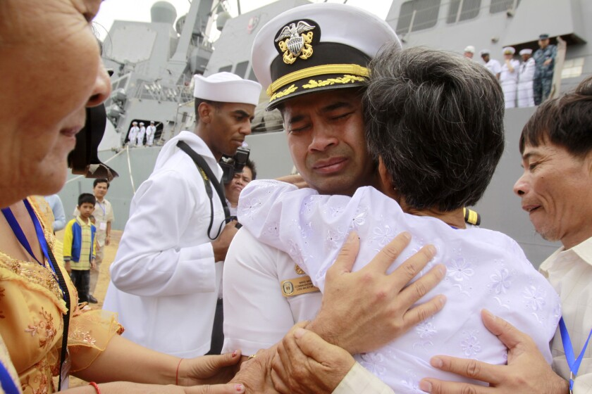 Cmdr. Michael Vannak Khem Misiewicz embraces his aunt at the port of Sihanoukville, Cambodia, in 2010.