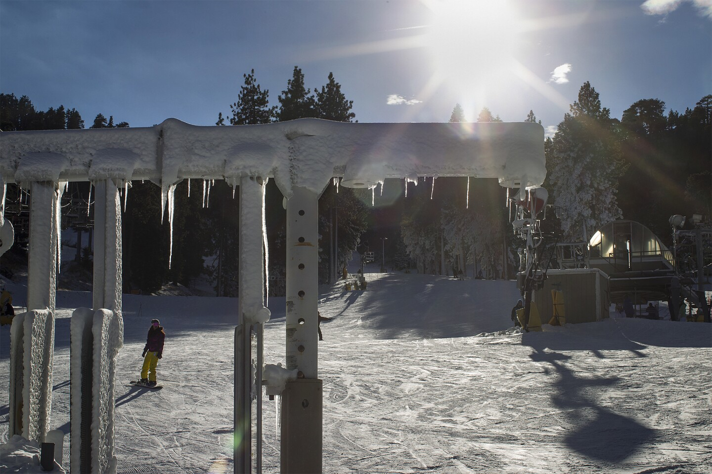 Icicles form while snowboarders enjoy the early ski season at Mountain High Ski Resort in Wrightwood.