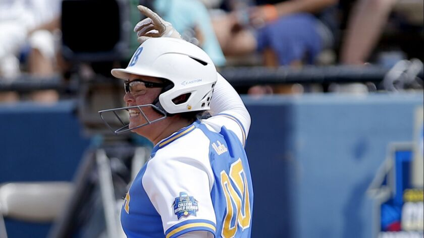 UCLA's Rachel Garcia celebrates a three-run home run in the 10th inning against Washington during a