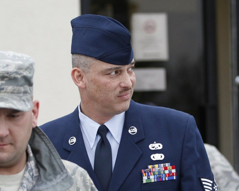 FILE - In this Jan. 19, 2011 file photo is Air Force Sgt. David Gutierrez, right, at McConnell Air Force Base in Wichita, Kan. The attorney for the Kansas airman says a ruling on Monday, Feb. 23, 2015 by the nation's highest military court that reversed his client's conviction for exposing multiple sex partners to HIV will effectively end such prosecutions in the armed forces. (AP Photo/Jeff Tuttle, File)