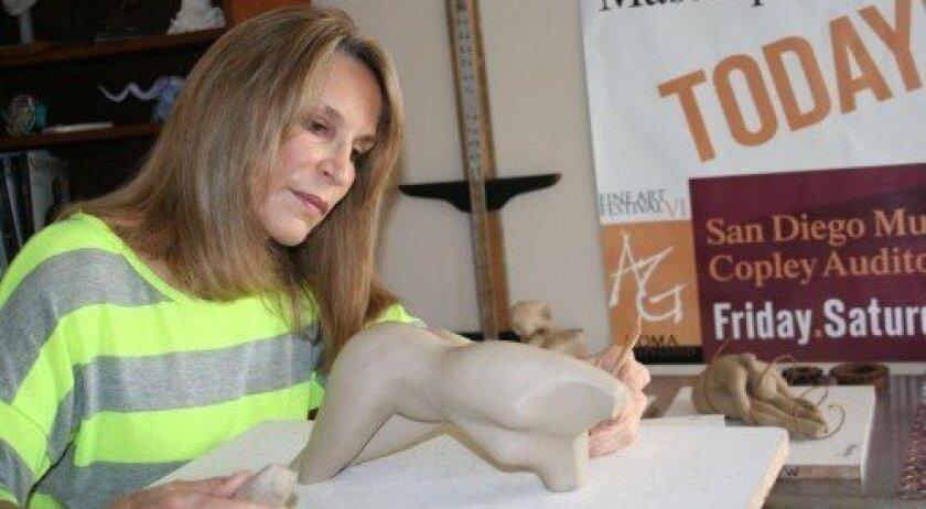 Del Mar sculptor Maidy Morhous works in her studio. Photo: Karen Billing