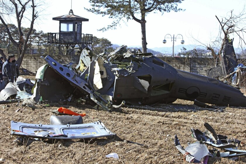 The wreckage of a South Korean army's helicopter lies on a farming field in Chuncheon, South Korea, Monday, Feb. 15, 2016. The South Korean military helicopter has crashed in an eastern province, killing three of the four soldiers on board. (Park Young-suh/Yonhap via AP) KOREA OUT