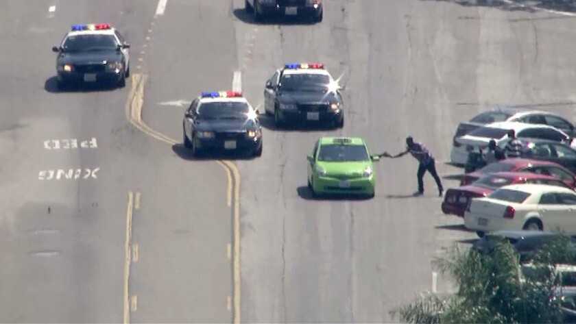 Police pursue a taxi in Los Angeles on Friday.