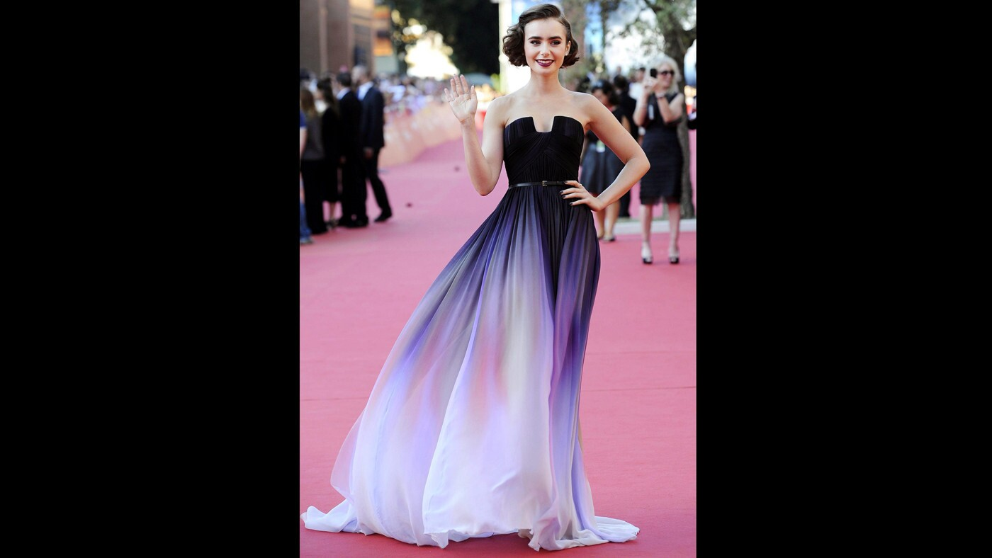 """British actress Lily Collins arrives for the premiere of the movie """"Love, Rosie"""" at the ninth annual Rome Film Festival on Oct. 19."""