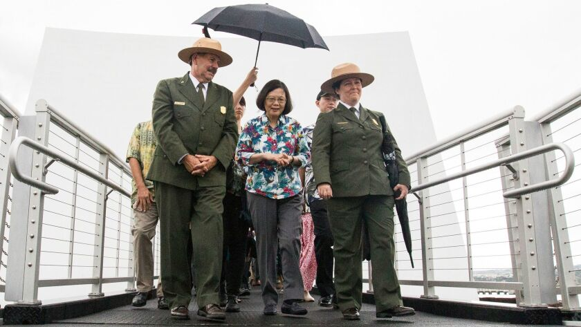 Taiwan President Tsai Ing-wen leaves the USS Arizona Memorial with National Park Services Chief Historian Daniel Martinez and Superintendent Jacqueline Ashwell in Honolulu in October,