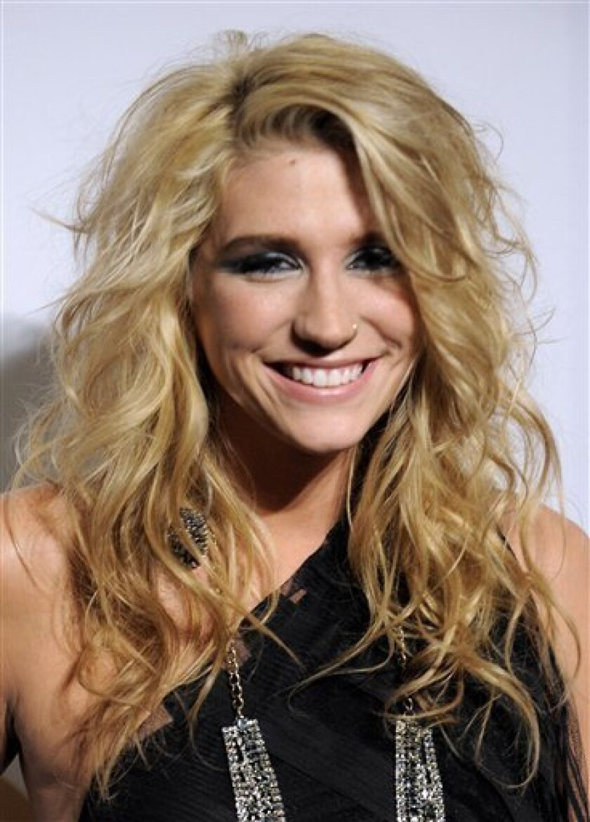 Ke$ha arrives at the annual Pre-GRAMMY Gala presented by The Recording Academy and Clive Davis on Saturday, Jan. 30, 2010 at The Beverly Hilton Hotel in Beverly, Hills, California. (AP Photo/Chris Pizzello)
