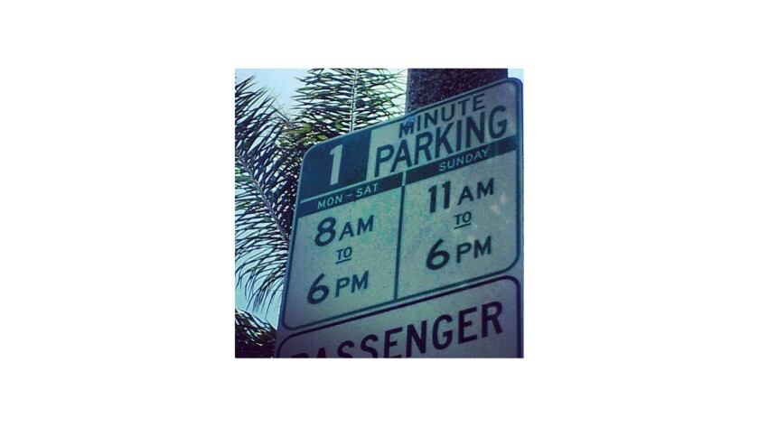 """A parking sign on San Vicente Boulevard says """"1 Minute Parking"""" instead of """"1 Hour Parking."""" Times staffer Laura Davis originally posted this photo to Instagram, then it went hot on Reddit."""