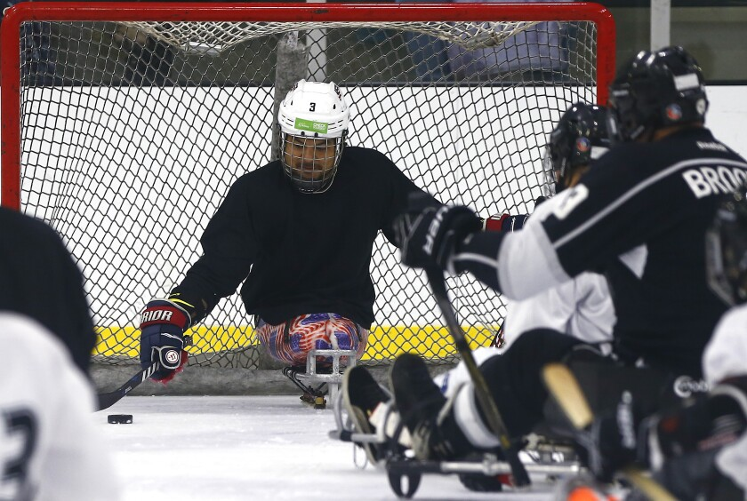 Ralph DeQuebec goaltends during a sled hockey clinic at Great Park Ice rinks in Irvine on Saturday.