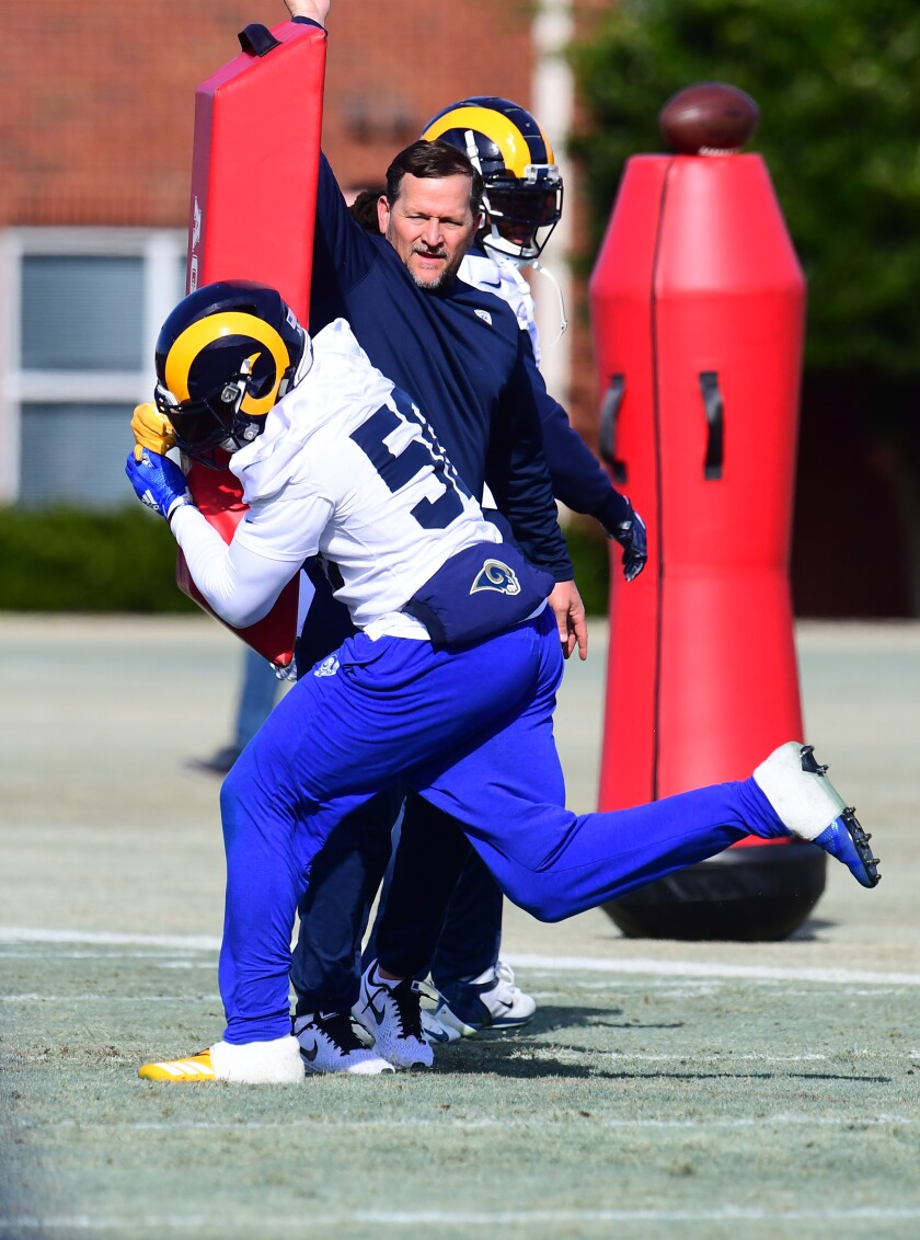 Rams linebacker coach Joe Barry works with Cory Littleton during practice.