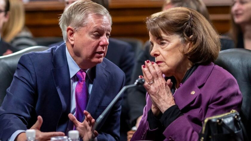 Senate Judiciary Committee Chairman Lindsey Graham (R-S.C.), left, and Sen. Dianne Feinstein (D-Calif.), the ranking member, confer as the panel meets on Capitol Hill in Washington, Tuesday, Jan. 29, 2019.
