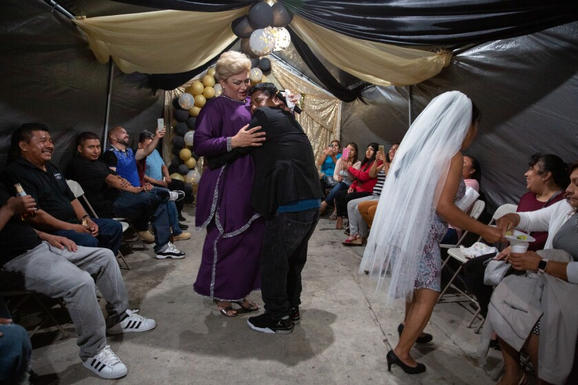 "In one of Arlene Mejorado's photos for her ""Caricias"" project, a groom-to-be holds Barbara Towne while she performs as Paquita la del Barrio at a bachelor-bachelorette party in Compton. Towne is a transgender woman from Honduras who performed as three different divas at the party."