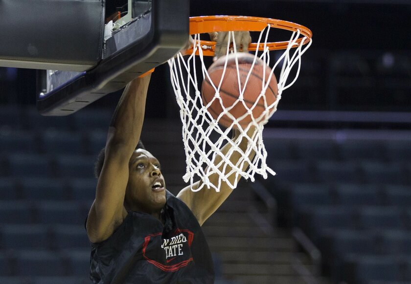 SDSU Mens Basketball Team goes through practice at Time Warner Cable Arena in Charlotte,North Carolina. Malik Pope with a  practice dunk Thursday.