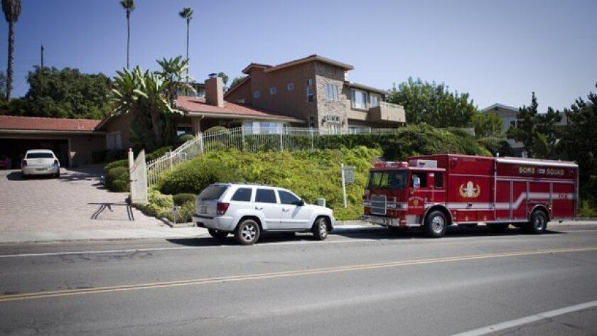 Authorities outside the house on Madra Avenue in Del Cerro during the explosives investigation.
