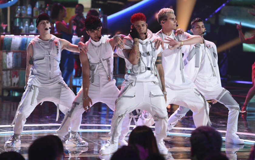 File - This Oct. 17, 2019, file photo shows Christopher Velez, from left, Joel Pimentel, Richard Camacho, Zabdiel de Jesuz, Erick and Brian Colon, of CNCO, performing at the Latin American Music Awards in Los Angeles. The Latin American boy band CNCO is downsizing. The group announced on its official Instagram page Sunday, May 9, 2021, that 22-year-old Pimentel is leaving the band, making the successful quintet a quartet. (Photo by Chris Pizzello/Invision/AP, File)