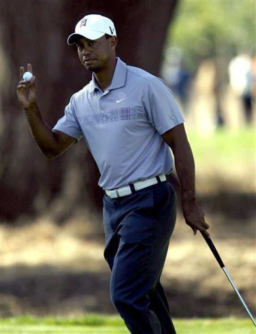 Tiger Woods birdied the 11th at the second round of the Frys.Com Open golf tournament, Friday, Oct. 7, 2011, in San Martin, Calif. (AP Photo/Dino Vournas)