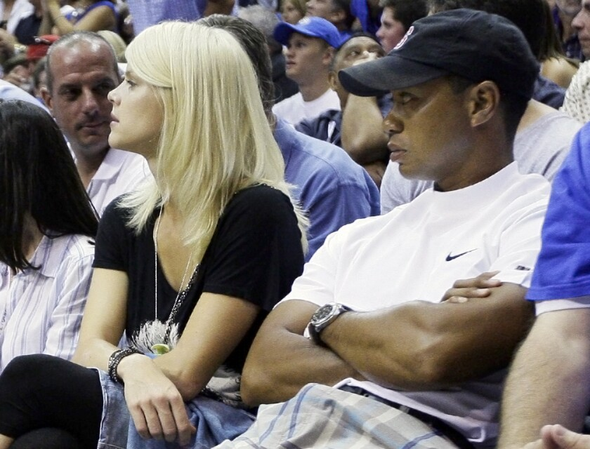 Tiger Woods and his wife, Elin Nordegren, watch Game 4 of the 2009 NBA Finals between the Lakers and Orlando Magic.
