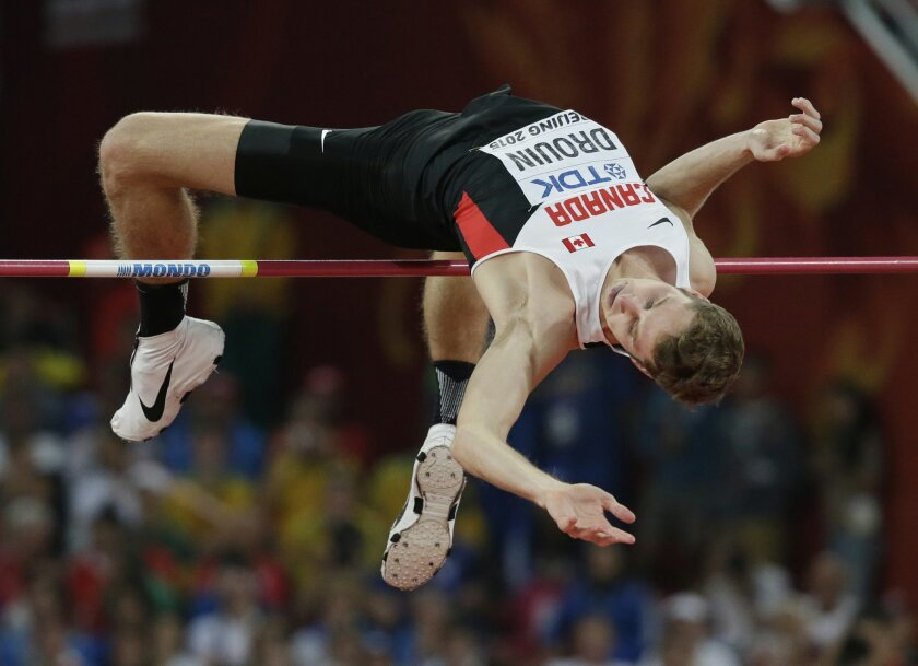 Canada's Derek Drouin clears the bar in the men's high jump final at the World Athletics Championships at the Bird's Nest stadium in Beijing, Sunday, Aug. 30, 2015. (AP Photo/Andy Wong)