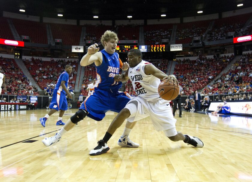 Chase Tapley (right) drives on Boise's Jeff Elorriaga during the Aztecs basketball games against Boise State during the quarterfinals of the Mountain West Champion Tournament in Las Vegas.