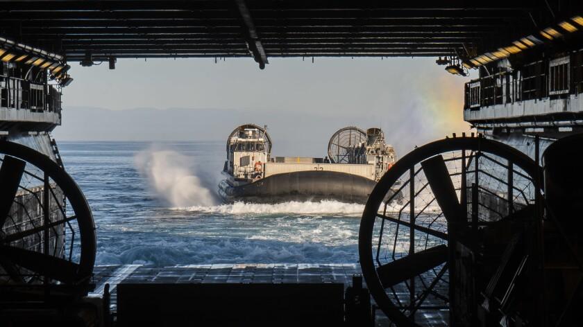 A landing craft, air cushion boards the Wasp-class amphibious assault ship USS Essex.