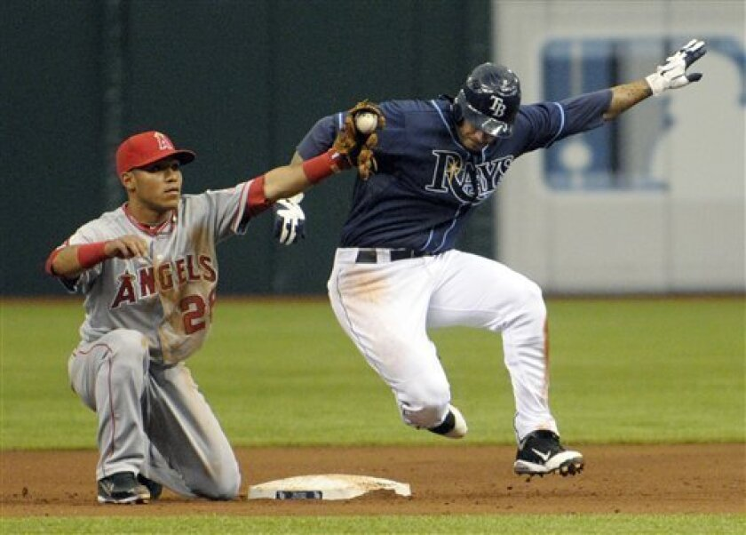 Tampa Bay Rays' Felipe Lopez, right, is tagged out by Los Angeles Angels second baseman Alexi Amarista while trying to steal second base during the fifth inning of a baseball game in St. Petersburg, Fla., Saturday, April 30, 2011.(AP Photo/Phelan M. Ebenhack)