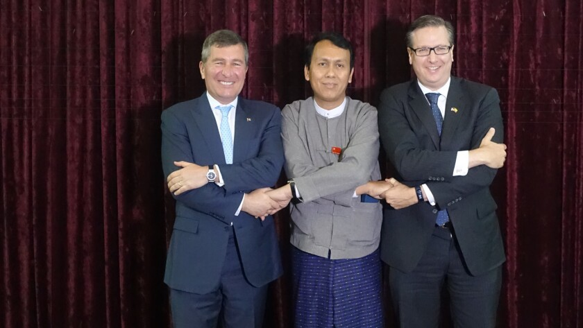 U.S. Assistant Secretary of State Charles Rivkin, left, with U Phyo Min Thein, chief minister of the Yangon region, middle, and US-ASEAN Business Council chief Alexander Feldman in Yangon.