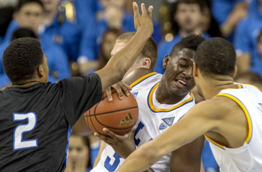 UCLA's Jordan Adams pulls down a rebound against Cal State San Bernardino during an exhibition game last week.