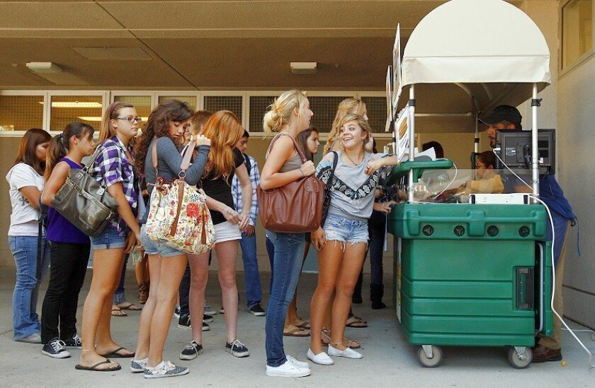 Students stood in line recently at one of the new lunch carts at Scripps Ranch High School. The carts sell Asian bowls, grilled-to-order burgers, salads and wraps.