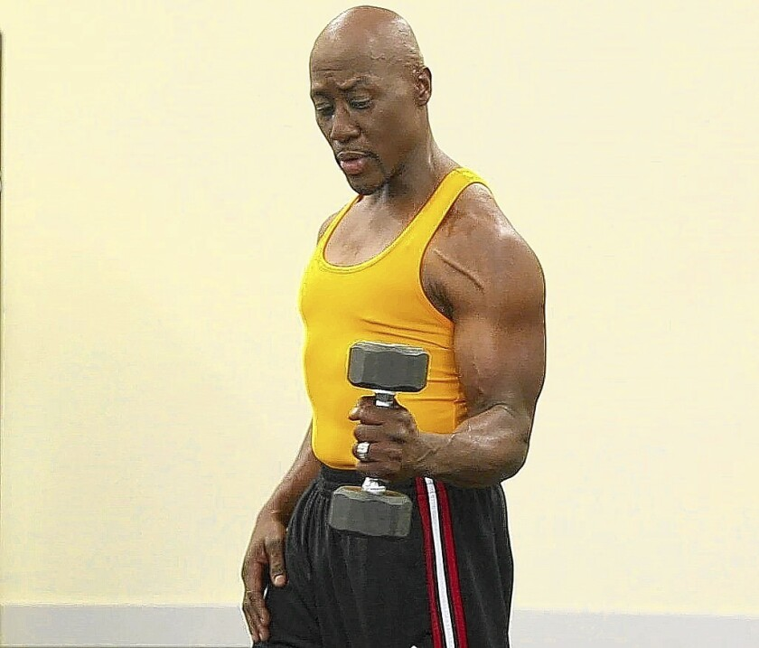 Dr. Levi Harrison demonstrates the rotator cuff exercise with dumbbell.