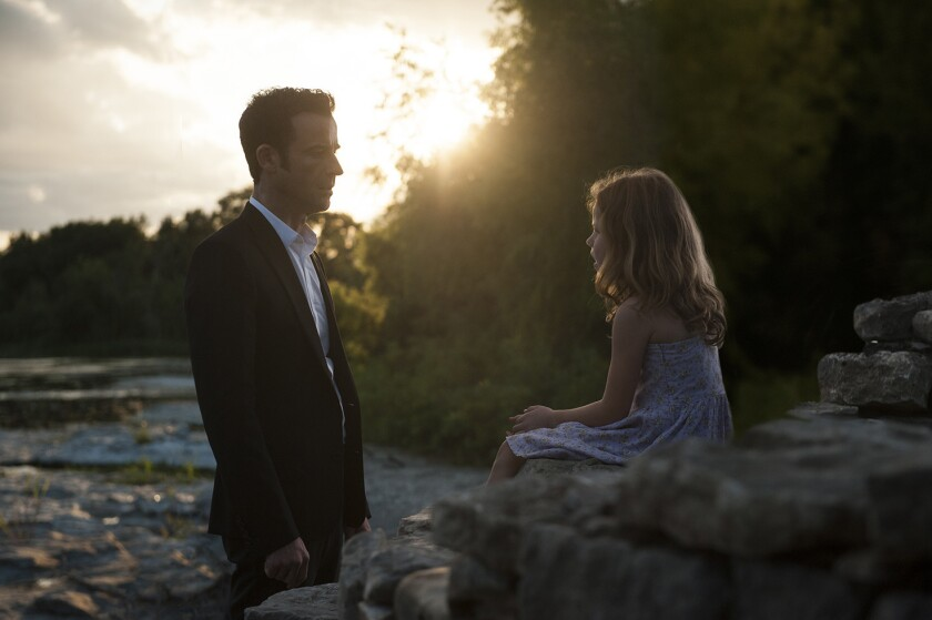 """Justin Theroux, left, portrays Kevin Garvey and Darby Camp portrays a young Patti on HBO's """"The Leftovers."""""""