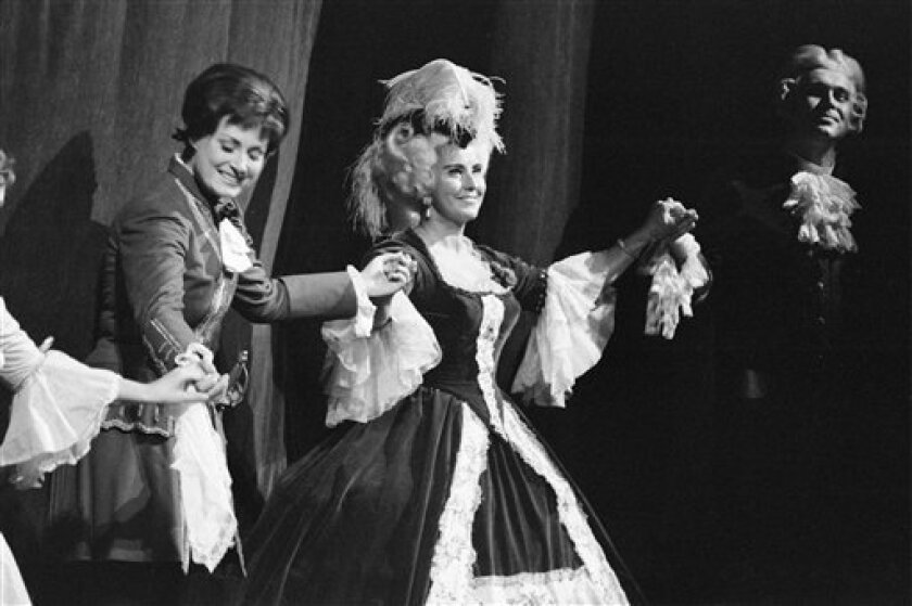 """FILE - This is an October 1973 file photo of Swiss opera singer Lisa della Casa, center, as she performs on stage at the Zurich Opera """"Opernhaus Zuerich"""", Switzerland, . According to media reports on Tuesday, Dec. 11, 2012, Lisa della Casa died at the age of 93 at Muensterlingen at the Lake of Constance, Switzerland. (AP Photo/Keystone/file) NO ARCHIVE"""