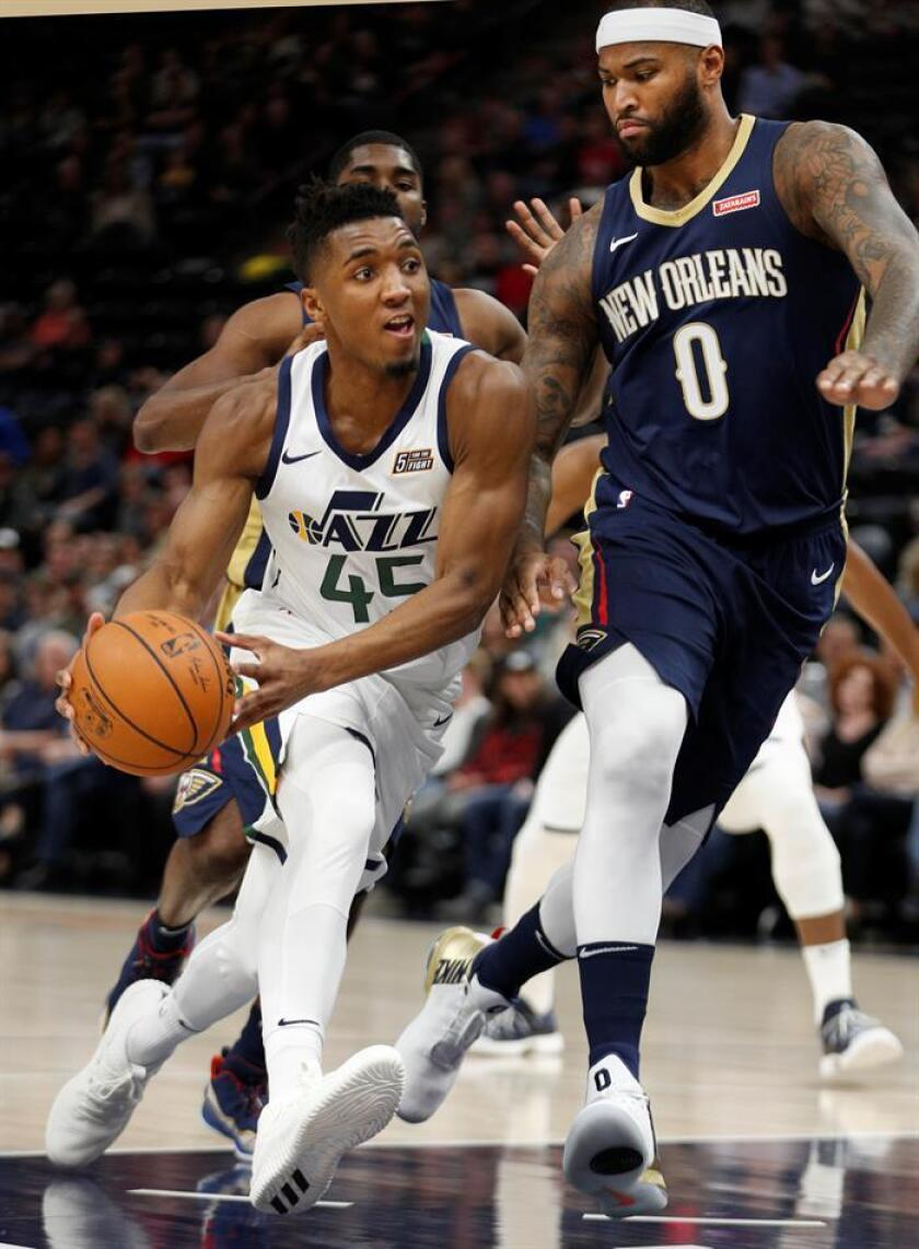 Utah Jazz guard Donovan Mitchell (45) drives to the basket past New Orleans Pelicans center DeMarcus Cousins (0) at an NBA game at Energy Solutions Arena in Salt Lake City, Utah, 1 December 2017. EFE